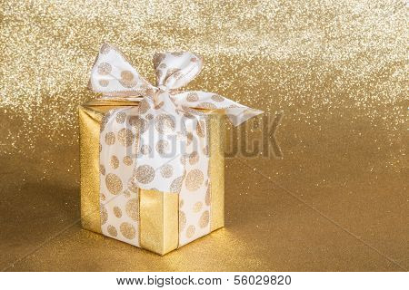 Golden gift wrapped present