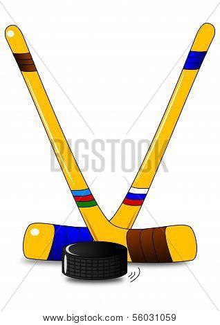 Ice hockey - two hockey sticks and puck