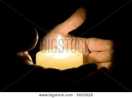 Human Hands Holding Candle