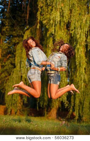 Two Teenage Girls Jumping