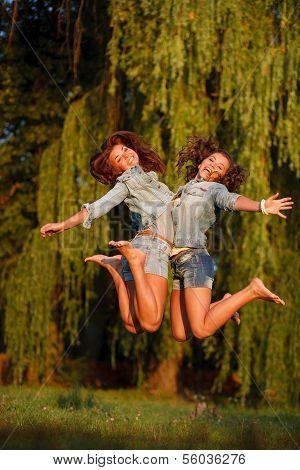 Two Teenage Girls Jumping