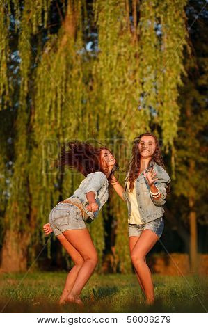 Two Teenage Girls Dancing
