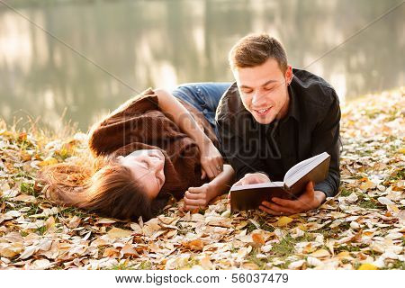 Young Man Reading To His Girlfriend