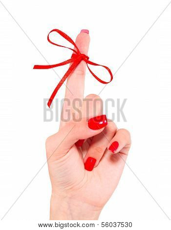 Red bow on finger,