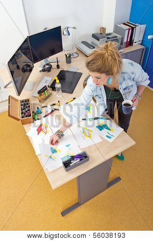 The creative process of a product designer at work in her office studio