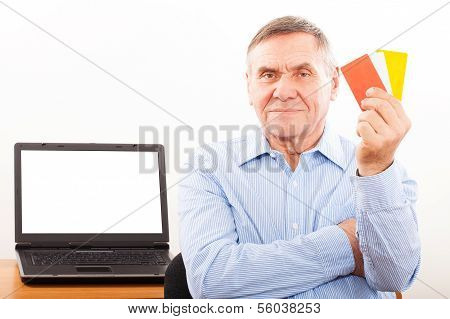 Elderly man smiling and showing credit card
