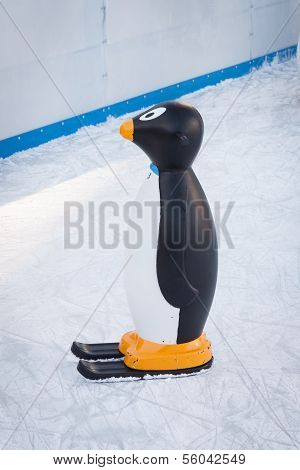 A penguin for helping children while skating In Milan, Italy