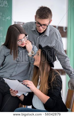 Highschool students with glasses studying in classroom