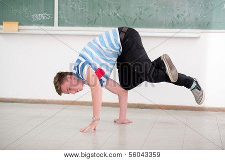 Student breakdancing in school classroom