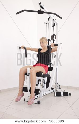 Young Blond Woman Working Out In Gym