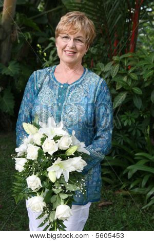 Mature Woman With Flowers.