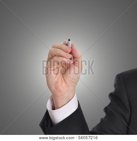 Businessman writing with marker isolated on gray background. Plenty of room for a message.