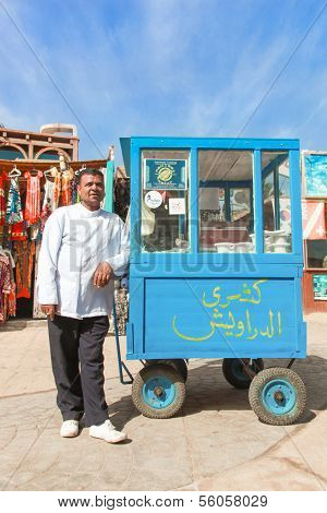DAHAB, EGYPT - JANUARY 29, 2011: Vendor on the street next to stand on January 28, 2011 in Dahab, Egypt. Street food is the cheapest way for tourists to get a meal.
