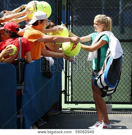Professional tennis player Agnieszka Radwanska signing autographs after practice for US Open 2013