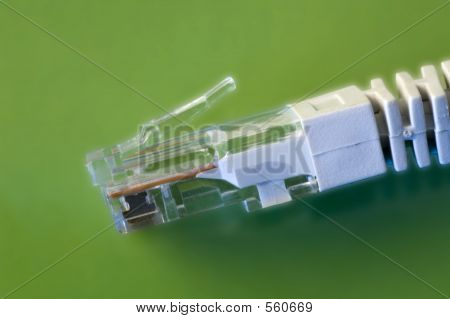 Network Cable Against Green Background