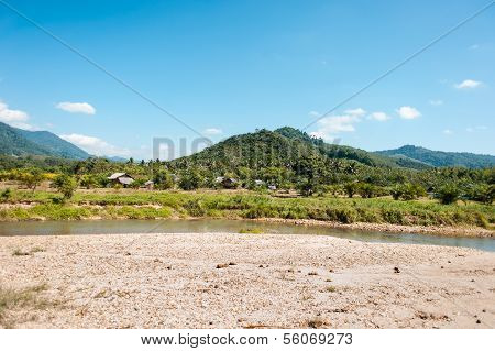 Small River, Hills And Sand