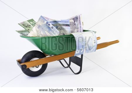 Green Wheel Barrel Full Of Dollars Bills Side View