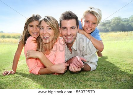 Portrait of happy family in summer time