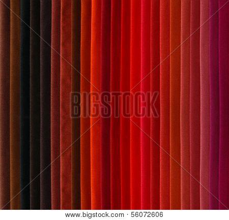 Red, brown, violet warm color textile samples