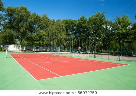 Outdoor tennis court with nobody