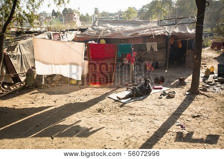 KATHMANDU, NEPAL - DEC 16: Unidentified poor people near their houses at slums in Tripureshwor district, Dec 16, 2013 in Kathmandu, Nepal. Caste of untouchables in Nepal, is about 7 % of population.