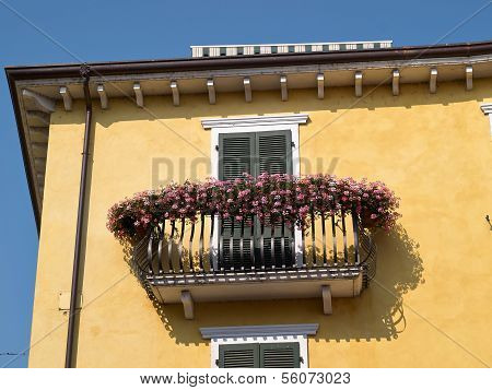 Typical Italian House Balcony With Flowers