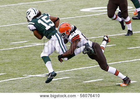NEW YORK-DEC 22: Cleveland Browns outside linebacker Barkevious Mingo (51) attempts to tackle New York Jets wide receiver Saalim Hakim (15) during the first half at MetLife Stadium.