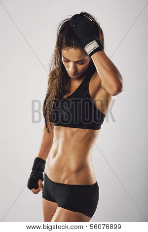 Woman Boxer Resting After Boxing Practice
