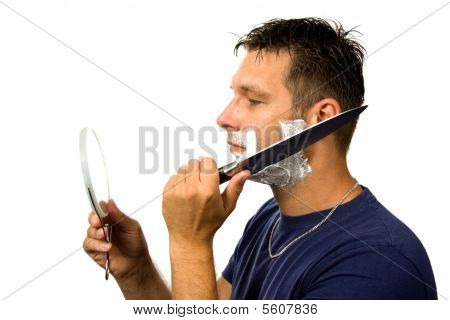 Man Is Shaving His Face With Knife