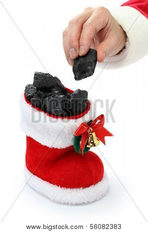 the hand of Santa Claus has put coal in the stocking, christmas present for bad boys and bad girls