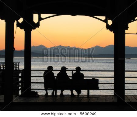 Three Silhouettes At Sunset