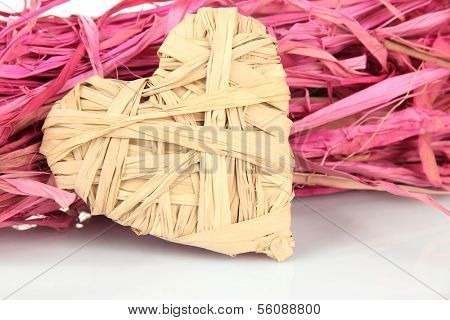 Decorative straw for hand made and heart of straw, isolated on white