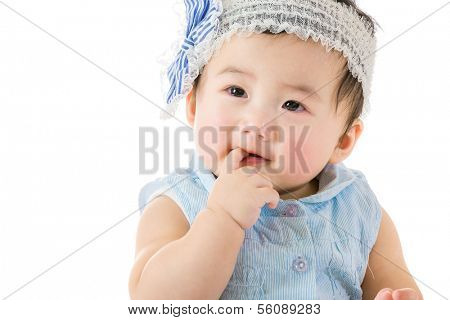 Baby girl sucking finger