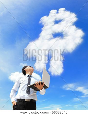 Business Man With Laptop And Look Bitcoin Cloud