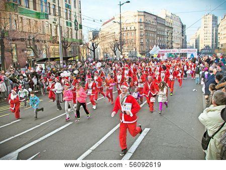 BELGRADE, SERBIA - DECEMBER 29, 2013: Unidentified participants of the sixth annual Belgrade Santa's Race on Dec. 29, 2013 in Belgrade, Serbia