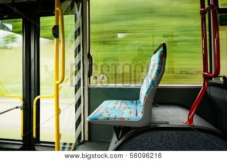 Empty Seat In A Trolley Bus. Blurred Background