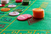 image of roulette table  - roulette game with game table and green poker chips - JPG