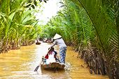 picture of conic  - A famous tourist destination is  Ben Tre village in Mekong delta  - JPG
