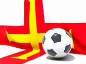 Flag Of Guernsey With Football In Front Of It