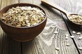 stock photo of porridge  - Oatmeal in a brown wooden bowl on the table - JPG