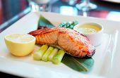 Salmon steak cooked in asian style on restaurant table