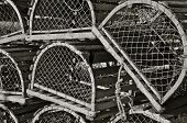 stock photo of lobster trap  - Old wooden lobster traps or pots stacked upon each other - JPG