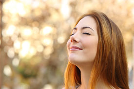 pic of breathing exercise  - Portrait of a beautiful woman doing breath exercises with an autumn unfocused background - JPG