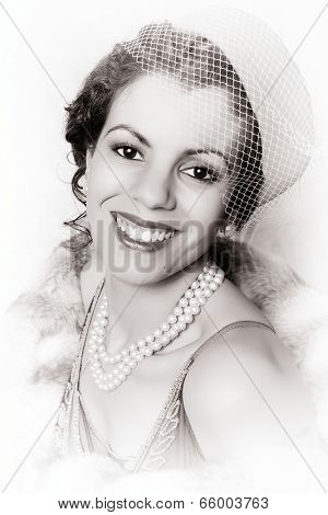 Vintage 1920s woman wearing a pink pillbox hat