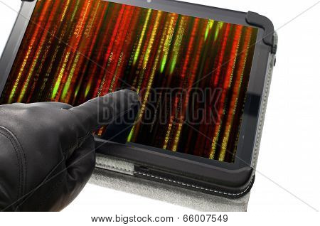 Online Illegal Activity Concept With Hand Wearing Black Glove Pointing A Tablet Screen