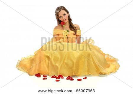 Portrait of young woman dressed in princess costume isolated over white background