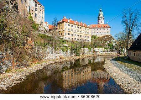 Castle with the famous round tower in Cesky Krumlov, Czech Republic is reflecting in the river Vltava
