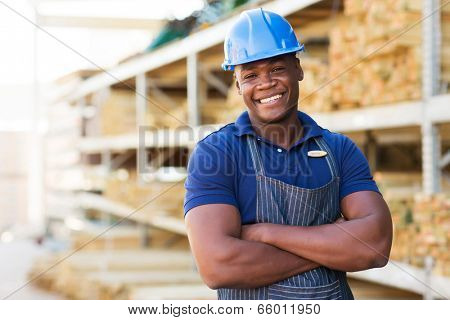 handsome african male warehouse worker with arms crossed