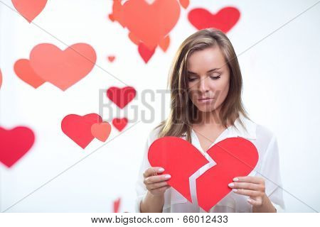 Young girl holding a broken heart