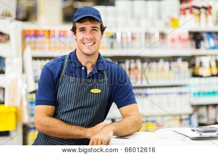 handsome hardware store worker looking at the camera
